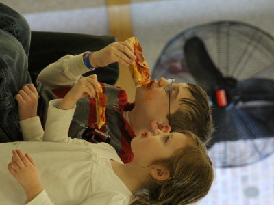 boy and girl enjoying pizza